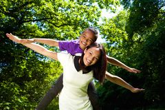 Young mother and son with arms spread Royalty Free Stock Photo