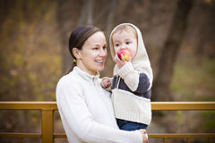 Young mother with son in autumn park Stock Photography