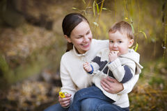 Young mother with son in autumn park Royalty Free Stock Images