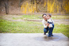Young mother with son in autumn park Royalty Free Stock Photo