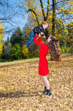 Young Mother and son in autumn park. happy family: mother and child boy play cuddling on autumn walk in nature outdoors. Young Mother and son in autumn park stock photo