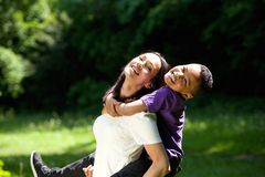 Young mother and son enjoying piggyback Royalty Free Stock Images
