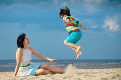 Young mother and son having fun on the beach Stock Photo