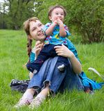 Young mother with son outdoor Royalty Free Stock Photos