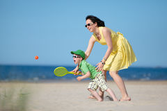 Young mother and son playing on the beach Stock Photo