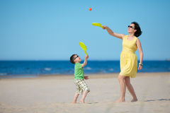 Young mother and son playing on the beach Royalty Free Stock Photography