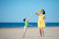 Young mother and son playing on the beach Royalty Free Stock Photos