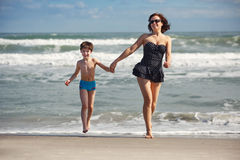 Young mother and son playing on the beach Royalty Free Stock Image
