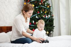 Young mother and son playing with RC controller Royalty Free Stock Image