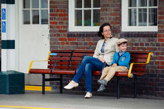 Young mother and son on railway station platform Royalty Free Stock Photo