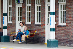 Young mother and son on railway station platform Stock Photography