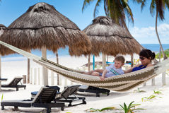 Young mother and son relaxing in a hammock Stock Photography
