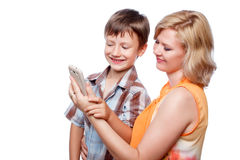 Young mother and son with smartphone Royalty Free Stock Photo