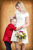 Young mother and son tenderly embrace.Spring concept of family vacation and family love. Women`s day. Spring concept of family vacation and family love. Women`s royalty free stock photography