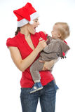 Young mother spending Christmas time with baby Royalty Free Stock Photos