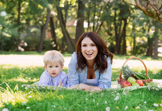 Young mother spending time with her son in the park having a picnic. Stock Photography