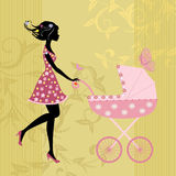 Young mother with stroller Royalty Free Stock Photo