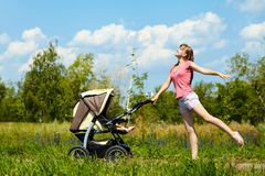 Young mother with a stroller Royalty Free Stock Image
