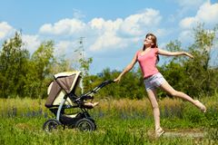 Young mother with a stroller Royalty Free Stock Photo