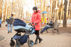 Young mother with   stroller Stock Image