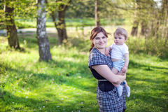 Young mother and sweet baby boy in summer forest Royalty Free Stock Images
