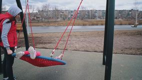 Little cute girl swinging on strong net round swing. stock video