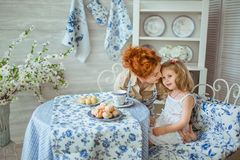 Young Mother Talks With Her Daughter At Kitchen Royalty Free Stock Photo