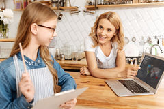 Young mother teaching her daughter basics of economics Royalty Free Stock Image