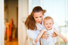 Young mother telling something to her baby Royalty Free Stock Photography