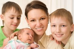 Young mother with three children Royalty Free Stock Photography