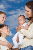 Young mother with three children Stock Photography