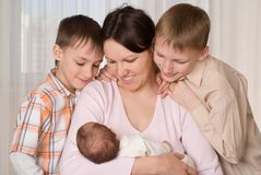Young mother with three kids Stock Photo
