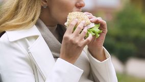 Young mother-to-be with big belly eating burger, suffering nausea, feeling sick. Stock footage stock footage