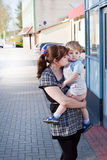 Young mother and toddler boy on city street Stock Photos