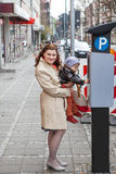 Young mother and toddler boy on city street Royalty Free Stock Photo