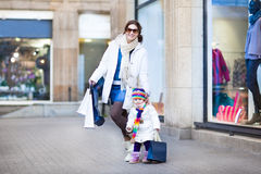 Young mother and toddler daughter enjoying shopping Royalty Free Stock Photo
