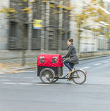 Young mother transports her child in a bicycle buggy in Berlin Royalty Free Stock Images