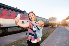 Young mother travelling with baby by train. stock photography