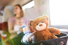 Young mother travelling with baby by train. Stock Photos
