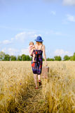 Young mother travelling with her child on hand on Royalty Free Stock Image