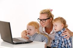 Young mother with two children Stock Photography