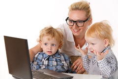 Young mother with two children Stock Image