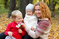 Young mother with two happy children Royalty Free Stock Images