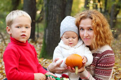 Young mother with two happy children Stock Images
