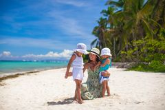 Young mother and two her daughters at exotic beach Stock Photos