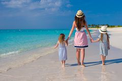 Young mother and two her kids at exotic beach on Stock Images