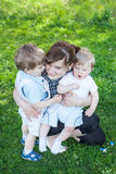 Young mother and two little boys Royalty Free Stock Images