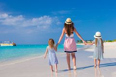 Young mother and two little kids at exotic beach Stock Image