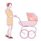 Young mother walking with baby. In baby carriage Stock Photo