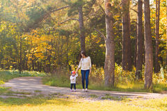 Young mother walking with her baby in an autumn Royalty Free Stock Photo